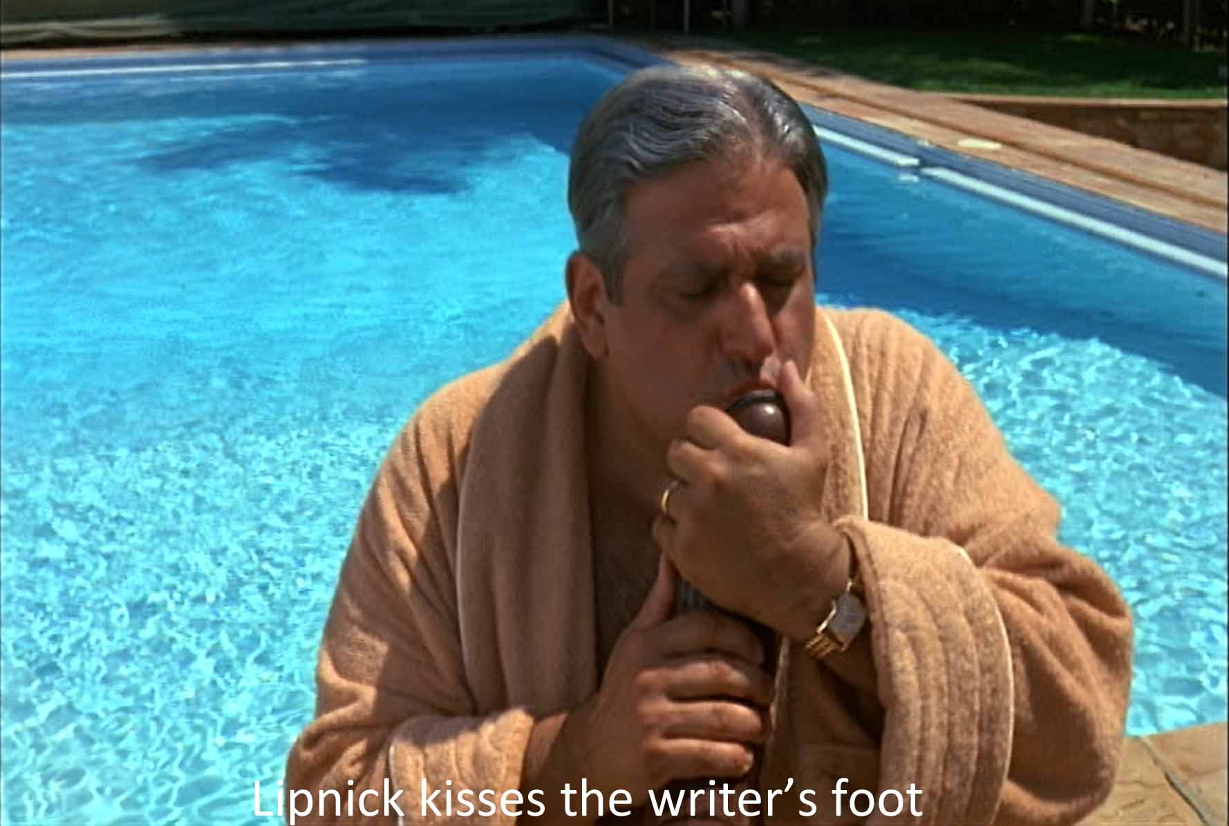 Lipnick kisses the writer's foot