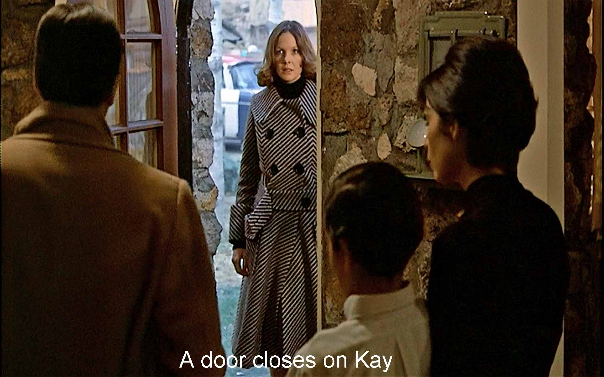 A door closes on Kay