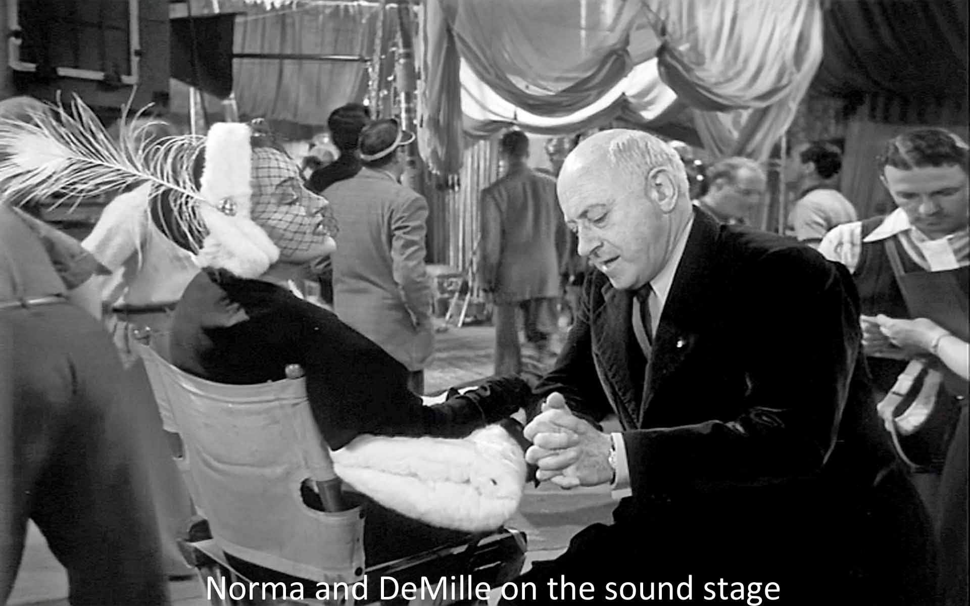 Norma and DeMille on the sound stage