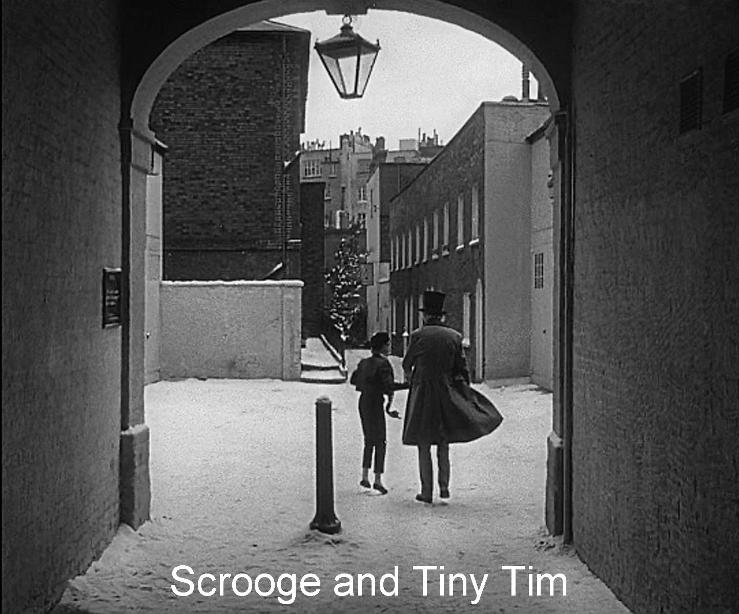 Closing scene: Scrooge and Tiny Tim
